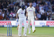 England's James Anderson, right, celebrates the dismissal of India's captain Virat Kohli, left, during the first day of third test cricket match between England and India, at Headingley cricket ground in Leeds, England, Wednesday, Aug. 25, 2021. (AP Photo/Jon Super)