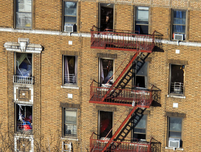 <p>A firefighter ladder lay, bottom left, on the wall as furniture is seen through the broken windows of a building Friday, Dec. 29, 2017, where New York City's deadliest residential fire in decades occured Thursday in the Bronx. (Photo: Andres Kudacki/AP) </p>