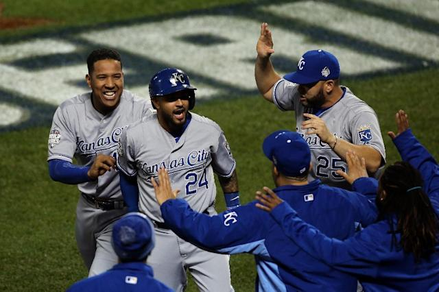 Christian Colon of the Kansas City Royals celebrates with his teammates after scoring in the 12th inning against the New York Mets during Game Five of the 2015 World Series at Citi Field on November 1, 2015 (AFP Photo/Doug Pensinger)