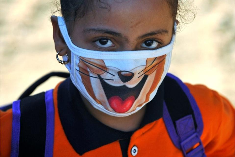 "A student wearing a protective face mask attends the first day""s class at El Safa school, following months of closure due to the coronavirus disease (COVID-19) outbreak in the Giza suburb of Awsim, Egypt October 18, 2020."