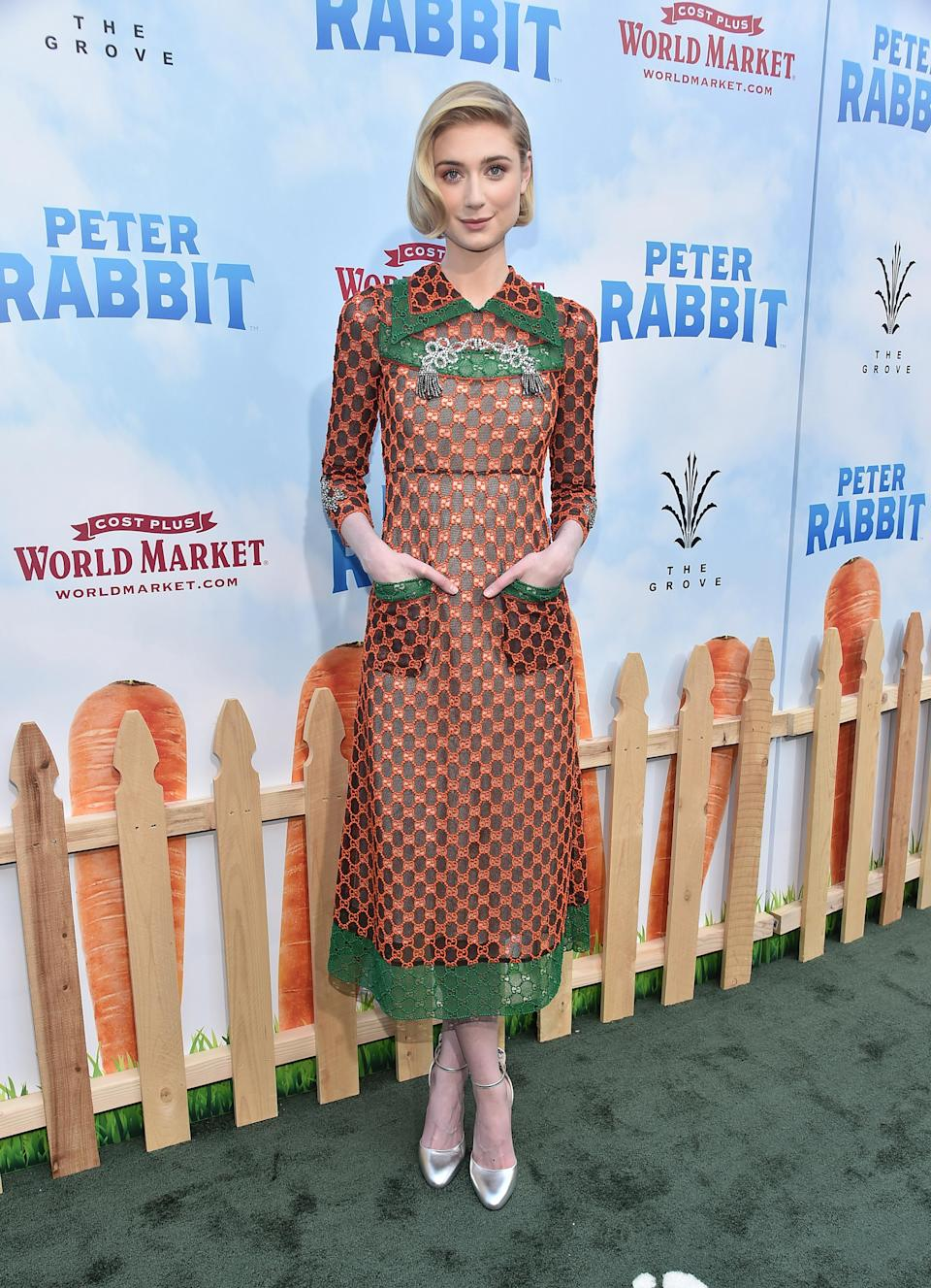 <p>'The Night Manager' star worked an orange and green printed Gucci dress. <em>[Photo: Getty]</em> </p>