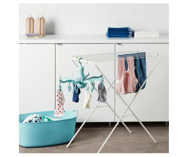 """This drying rack with clips will keep easy-to-lose items like socks and lingerie organized while they dry. Clip it onto an existing drying rack, hang it from a closet bar, or even attach it to your shower rod to keep it out of the way. <strong><a href=""""https://fave.co/2KiiYlb"""" target=""""_blank"""" rel=""""noopener noreferrer"""">Get it at IKEA, $5</a></strong>."""