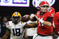 Georgia quarterback Jake Fromm (11) works against LSU during the first half of the Southeastern Conference championship NCAA college football game, Saturday, Dec. 7, 2019, in Atlanta. (AP Photo/John Amis)