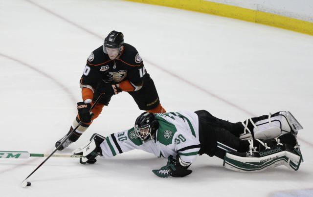 Anaheim Ducks' Corey Perry, top, shoots to score against Dallas Stars goalie Tim Thomas during the third period of Game 5 of the first-round NHL hockey Stanley Cup playoff series on Friday, April 25, 2014, in Anaheim, Calif. The Ducks won 6-2. (AP Photo/Jae C. Hong)