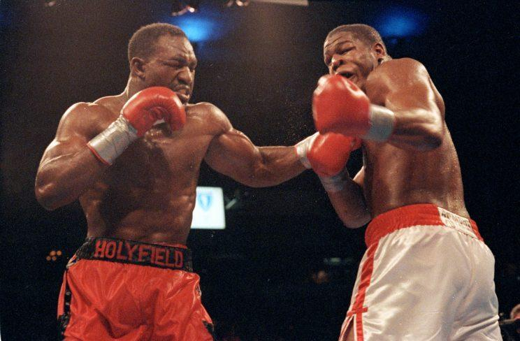 Evander Holyfield (L), shown during his epic 1992 fight with Riddick Bowe, will be inducted into the International Boxing Hall of Fame on Sunday in Canastota, New York. (Getty Images)