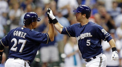 Milwaukee Brewers' Taylor Green, right, is greeted by Carlos Gomez after he hit a two-run home run off San Diego Padres' Dale Thayer in the seventh inning of a baseball game Friday, June 8, 2012, in Milwaukee. (AP Photo/Tom Lynn)