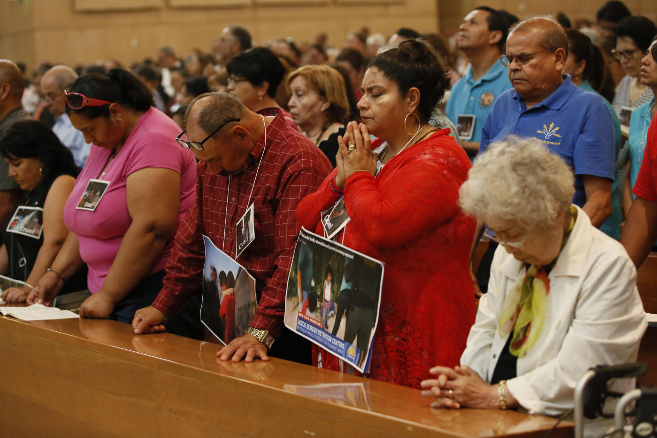 "Worshippers pray for immigrants at the ""Mass in Recognition of All Immigrants"" at the Cathedral of Our Lady of the Angels in Los Angeles. U.S Customs and Border Patrol said it had reunited 522 children and that some were never taken into custody by Health and Human Services because their parents' criminal cases were processed too quickly. Officials have said as many as 2,300 children had been separated from the time the policy began until June 9. It's not clear if any of the 2,000 remaining children were taken into custody after June 9. (AP Photo/Damian Dovarganes)"
