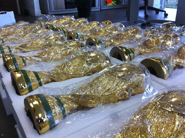 This photo taken on June 18, 2014 and provided Wednesday June 25, 2014 by the French Customs shows some World Cup counterfeit trophy replicas seized at Roissy airport, north of Paris. The 30 trophies were coming from China for the domestic market. (AP Photo/Douane Francaise)