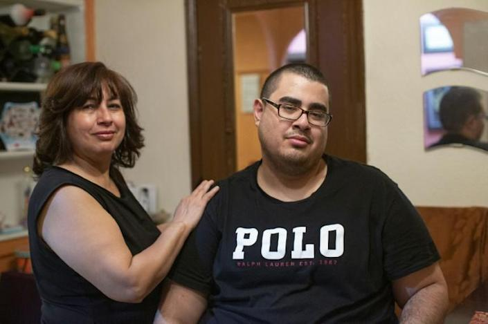 Gregory Rodriguez and his mother, Martha, pose at their home in New York on November 22, 2019 (AFP Photo/Kena Betancur)