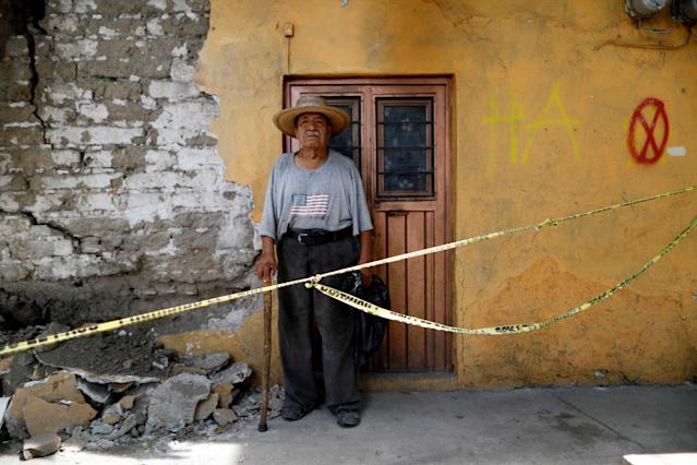 "<p>Luis Garcia, 79, a bricklayer, poses for a portrait outside a house that he built, after an earthquake in Jojutla de Juarez, Mexico, September 30, 2017. The sign reads, ""HA"" which means habitable. ""No house that I built was damaged by the earthquake,"" Garcia said. (Photo: Edgard Garrido/Reuters) </p>"