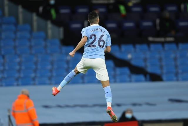 Riyad Mahrez celebrates scoring for City