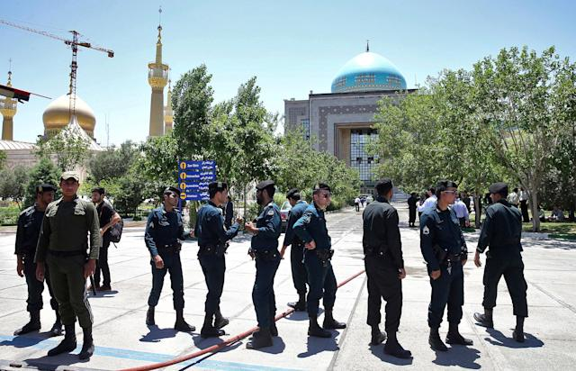 <p>Police officers control the scene, around of shrine of late Iranian revolutionary founder Ayatollah Khomeini, after an assault of several attackers in Tehran, just outside Tehran, Iran, Wednesday, June 7, 2017. (Photo: Ebrahim Noroozi/AP) </p>