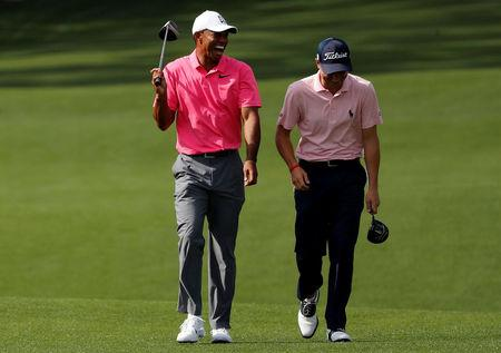Reed storms into Masters lead, Tiger just makes cut
