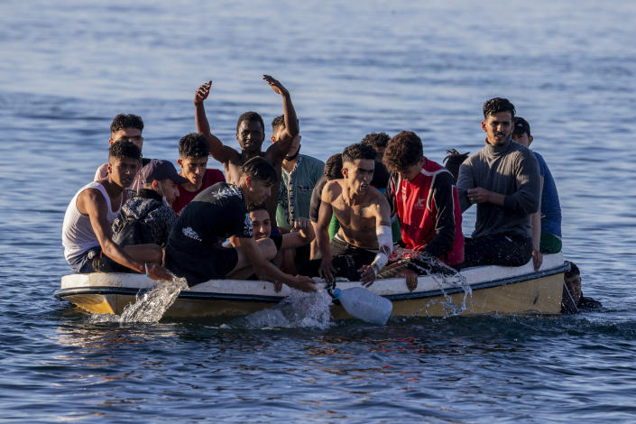 Migrants arrive at the Spanish enclave of Ceuta, near the border of Morocco and Spain, Wednesday, May 19, 2021. (AP Photo/Bernat Armangue)