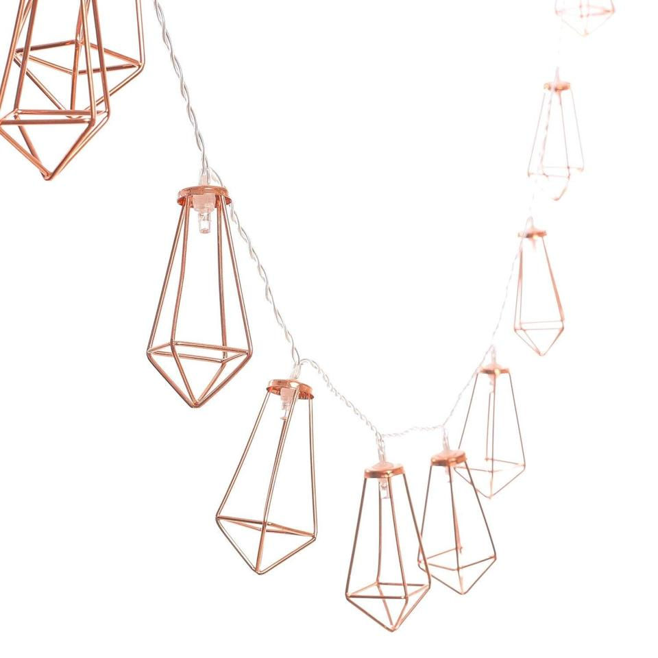 "<p>These <a rel=""nofollow noopener"" href=""https://www.popsugar.com/buy/Rose%20Gold%20Geometric%20String%20Lights-366007?p_name=Rose%20Gold%20Geometric%20String%20Lights&retailer=amazon.com&price=14&evar1=moms%3Aus&evar9=45367395&evar98=https%3A%2F%2Fwww.popsugar.com%2Fmoms%2Fphoto-gallery%2F45367395%2Fimage%2F45367415%2FRose-Gold-Geometric-String-Lights&prop13=desktop&pdata=1"" target=""_blank"" data-ylk=""slk:Rose Gold Geometric String Lights"" class=""link rapid-noclick-resp"">Rose Gold Geometric String Lights</a> ($14) will add flair to your teen's bedroom - they even light up!</p>"