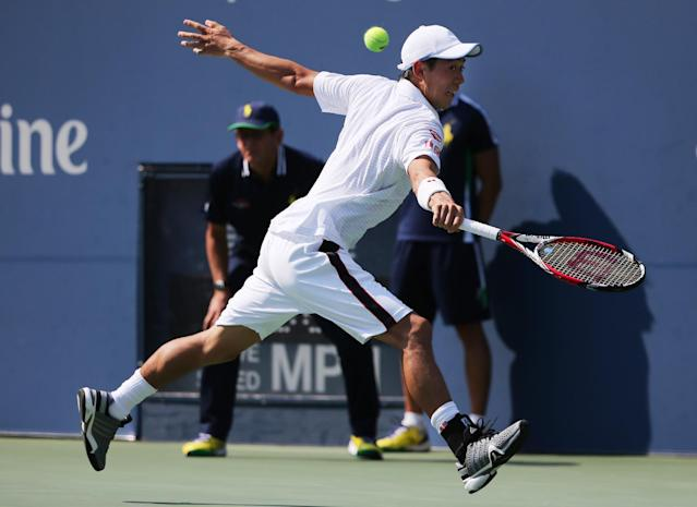 Kei Nishikori, of Japan, returns a shot against Novak Djokovic, of Serbia, during the semifinals of the 2014 U.S. Open tennis tournament, Saturday, Sept. 6, 2014, in New York. (AP Photo/Mike Groll)