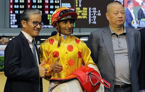 Pan Sutong (right), chairman of Goldin, is a regular at some of Hong Kong's horse races. Photo: SCMP