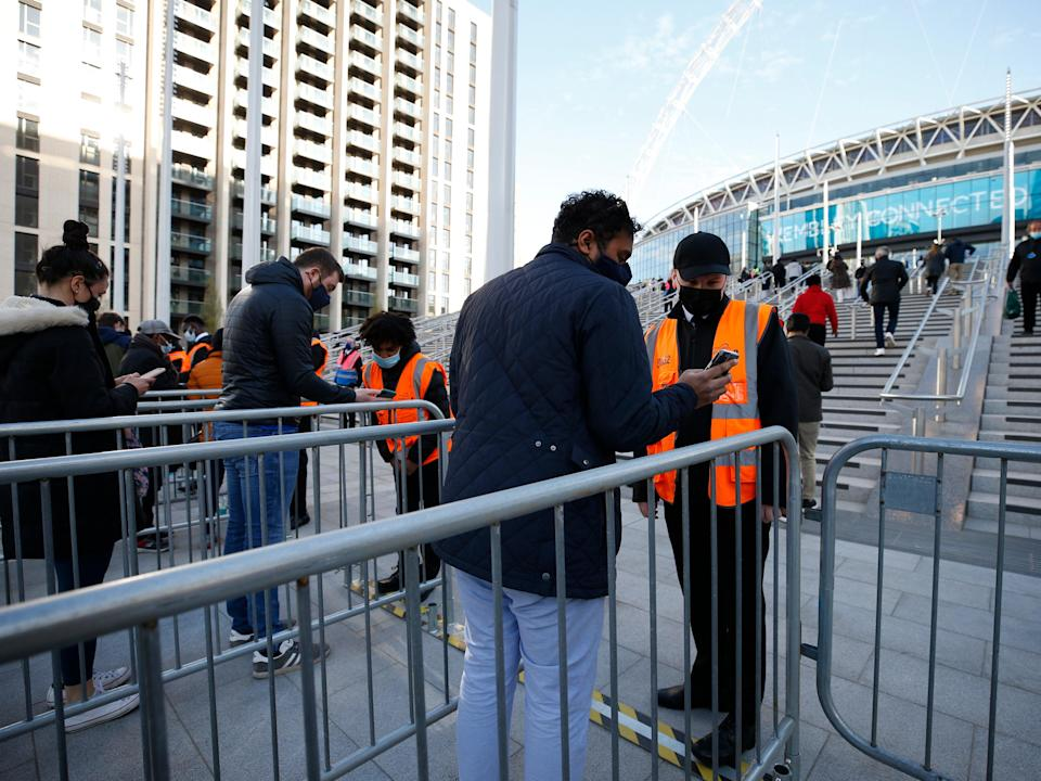 Football fans show their negative Covid-19 test results in order to enter Wembley Stadium for the FA Cup final (Getty Images)