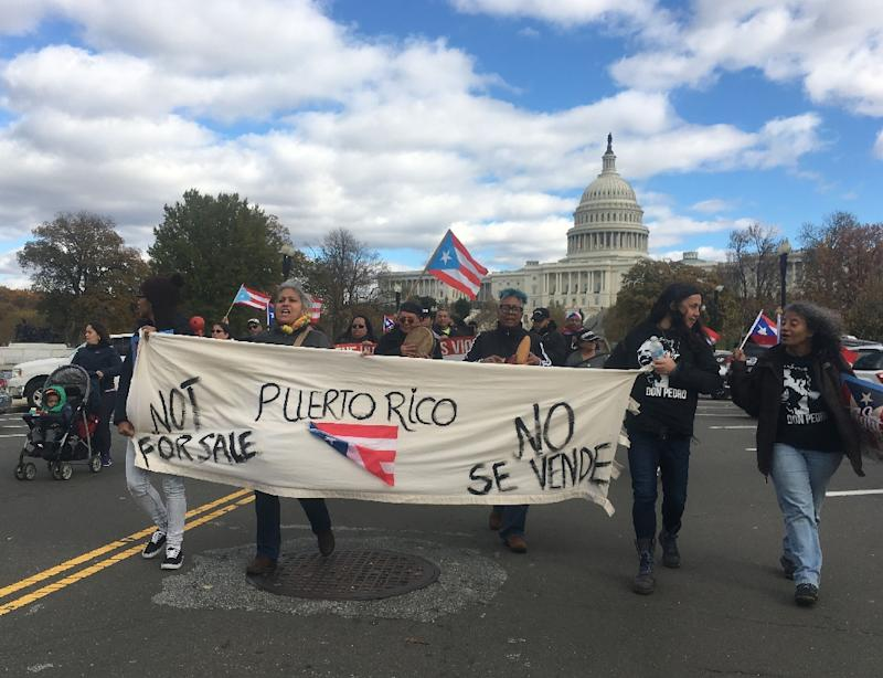 Protesters march in solidarity with storm-ravaged Puerto Rico, which is still reeling some two months after Hurricane Maria hit the island