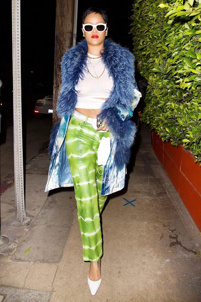 <p>Rihanna sports a chic pixie cut, blue faux fur coat and green tie dye pants to Giorgio Baldi for a late dinner on Wednesday in Santa Monica.</p>