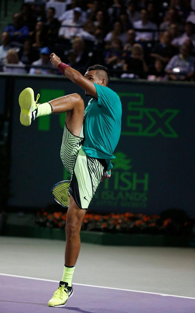 <span>The moment when Nick Kyrgios kicks the ball away in frustration - drawing jeers from the crowd</span> <span>Credit: AP </span>