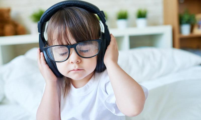 Starting day with musicCute kid girl listening to music in headphones