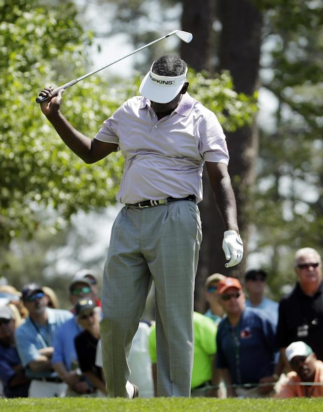Vijay Singh, of Fiji, swings his club after his tee shot on the fourth hole during the third round of the Masters golf tournament Saturday, April 12, 2014, in Augusta, Ga. (AP Photo/Chris Carlson)