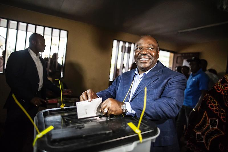 Gabon's President Ali Bongo casts his vote at a polling station in Libreville on August 27, 2016
