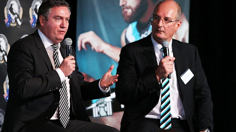 Eddie McGuire and David Koch, pictured here speaking to the media at the MCG.