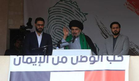 Iraqi Shi'ite cleric Moqtada al-Sadr speaks during a protest against corruption and informs his followers about his will at Tahrir Square in Baghdad