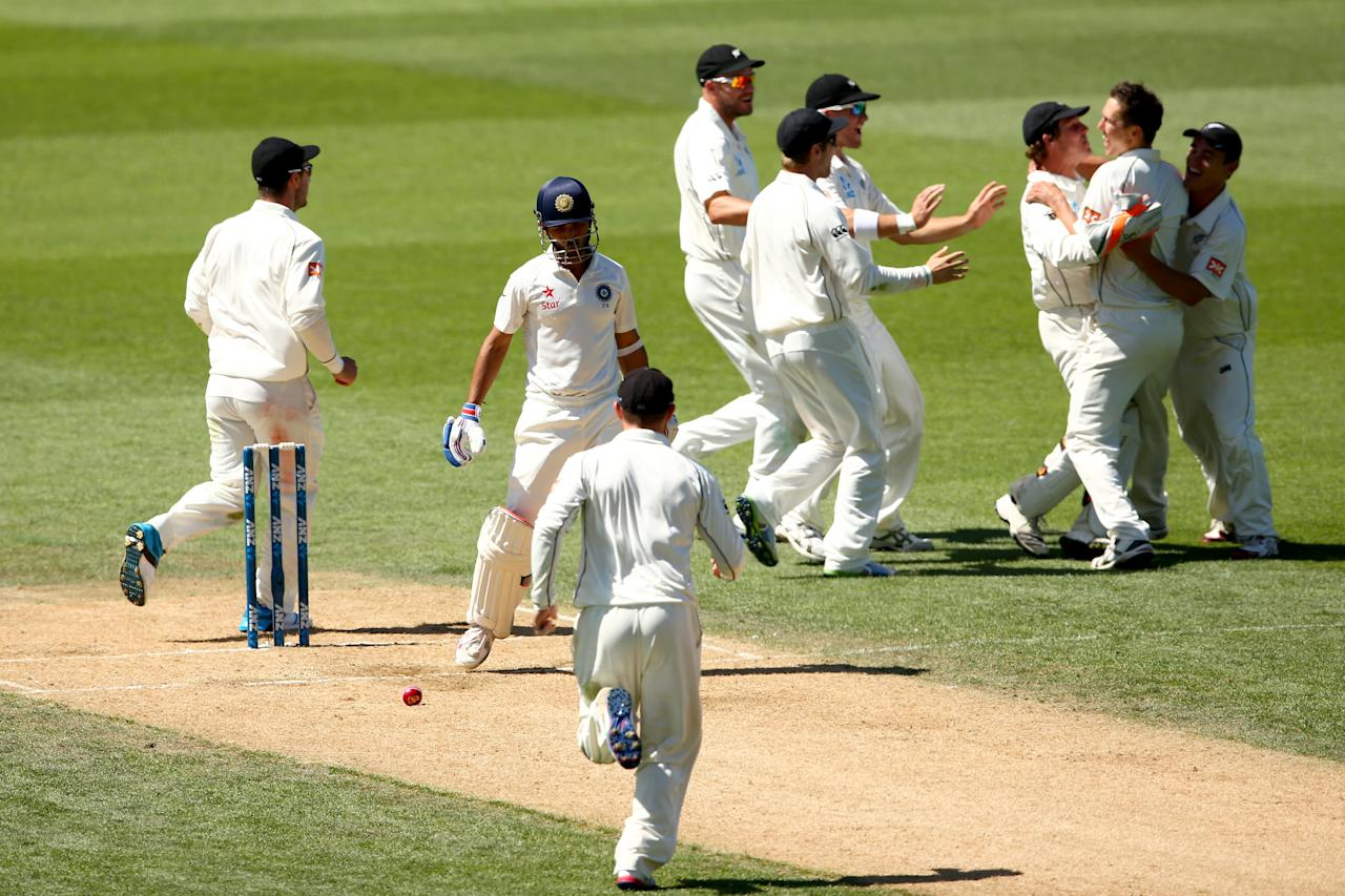 AUCKLAND, NEW ZEALAND - FEBRUARY 09:  Ajinkya Rahane of India departs after being trapped LBW by Trent Boult of New Zealand during day four of the First Test match between New Zealand and India at Eden Park on February 9, 2014 in Auckland, New Zealand.  (Photo by Phil Walter/Getty Images)