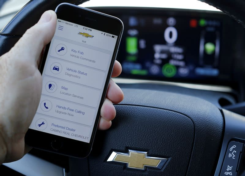 A mobile phone displays the OnStar app inside a Chevrolet Volt vehicle in this photo illustration taken in Encinitas