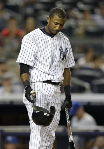 New York Yankees pinch hitter Eduardo Nunez drops his helmet after striking out swinging with Ichiro Suzuki at first in the seventh inning of a baseball game Kansas City Royals, Monday, July 8, 2013, in New York. (AP Photo/Kathy Willens)
