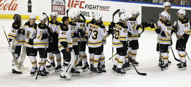 The Boston Bruins celebrate their 7-3 win against the Florida Panthers after an NHL hockey game, Saturday, March 23, 2019, in Sunrise, Fla. (AP Photo/Luis M. Alvarez)