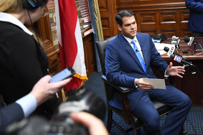 Georgia Lieutenant Governor Geoff Duncan speaks to the media while seated in his office in Atlanta. (AP Photo/John Amis)