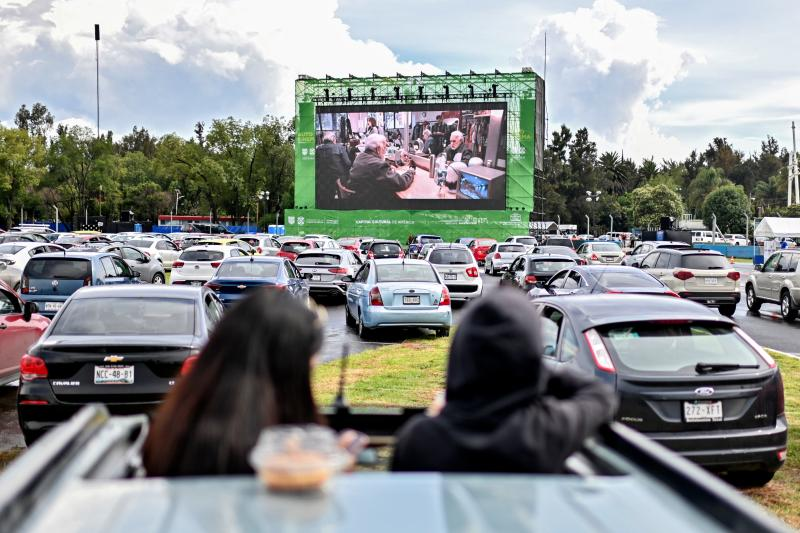 People attend a drive-in cinema set up at the Hermanos Rodriguez racetrack in Mexico City, on July 26, 2020, amid the novel coronavirus pandemic. (Photo by PEDRO PARDO / AFP) (Photo by PEDRO PARDO/AFP via Getty Images)