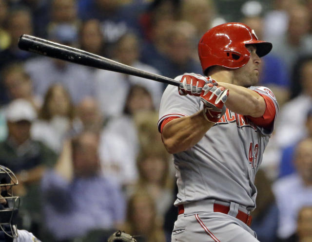 Cincinnati Reds' Scott Schebler watches his RBI-double during the fourth inning of a baseball game against the Milwaukee Brewers on Tuesday, Sept. 18, 2018, in Milwaukee. (AP Photo/Aaron Gash)
