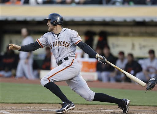San Francisco Giants' Hunter Pence follows through on an RBI single off Oakland Athletics starting pitcher Jarrod Parker during the first inning of a baseball game Tuesday, May 28, 2013, in Oakland Calif. (AP Photo/Eric Risberg)