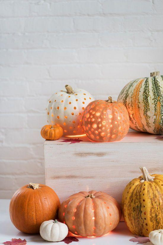 """<p>Pumpkin lanterns are the prettiest way to light a path to your home. A drill, pipe cleaner, and battery-powered pillar candles are all you need to craft them!</p><p><strong>Get the tutorial at</strong><strong> <a href=""""http://www.designlovefest.com/2015/10/make-it-pumpkin-lanterns/"""" rel=""""nofollow noopener"""" target=""""_blank"""" data-ylk=""""slk:Designlovefest"""" class=""""link rapid-noclick-resp"""">Designlovefest</a>.</strong></p><p><a class=""""link rapid-noclick-resp"""" href=""""https://go.redirectingat.com?id=74968X1596630&url=https%3A%2F%2Fwww.walmart.com%2Fsearch%2F%3Fquery%3Ddrills&sref=https%3A%2F%2Fwww.thepioneerwoman.com%2Fhome-lifestyle%2Fcrafts-diy%2Fg36982763%2Fpumpkin-carving-ideas%2F"""" rel=""""nofollow noopener"""" target=""""_blank"""" data-ylk=""""slk:SHOP DRILLS"""">SHOP DRILLS</a></p>"""