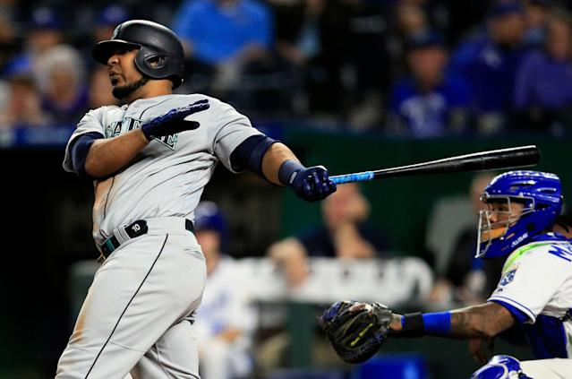 Seattle Mariners first baseman Edwin Encarnacion hits a three-run home run off Kansas City Royals pitcher Kevin McCarthy during the sixth inning. It was the second home run of the inning for Encarnacion. (AP Photo/Orlin Wagner)