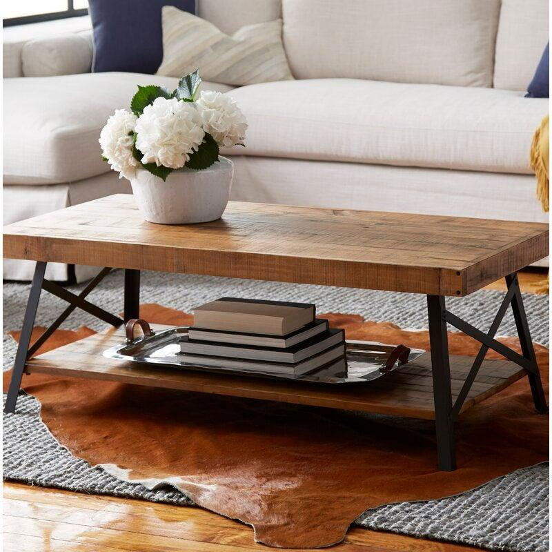 """<h2>55% Off Coastal Farmhouse Kinsella Coffee Table With Storage</h2><br><strong>12,314 reviews and 4.7 out of 5 stars</strong><br>""""By far my favorite pice so far. With the different colors in the wood and the black legs, it ties all of my random living room prices together allowing me to slowly make my small space comfy and cute all the same."""" <em>– Wayfair Reviewer</em><br><br><em>Shop <strong><a href=""""https://www.wayfair.com/furniture/pdp/coastal-farmhouse-kinsella-coffee-table-with-storage-w003264517.html"""" rel=""""nofollow noopener"""" target=""""_blank"""" data-ylk=""""slk:Wayfair"""" class=""""link rapid-noclick-resp"""">Wayfair</a></strong></em><br><br><strong>Coastal Farmhouse</strong> Kinsella Coffee Table with Storage, $, available at <a href=""""https://go.skimresources.com/?id=30283X879131&url=https%3A%2F%2Fwww.wayfair.com%2Ffurniture%2Fpdp%2Fcoastal-farmhouse-kinsella-coffee-table-with-storage-w003264517.html"""" rel=""""nofollow noopener"""" target=""""_blank"""" data-ylk=""""slk:Wayfair"""" class=""""link rapid-noclick-resp"""">Wayfair</a>"""