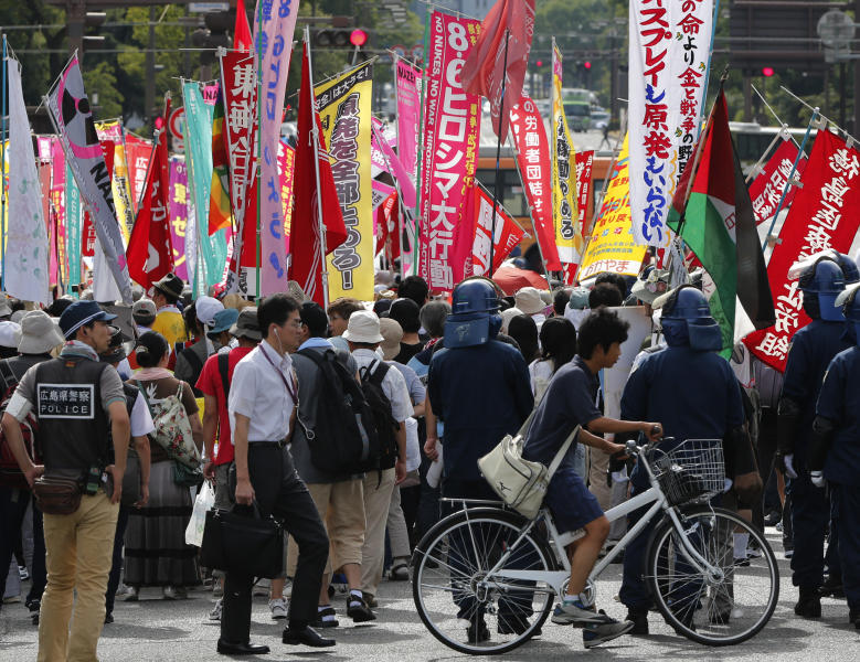 "Anti-nuclear protesters stage a rally in Hiroshima, western Japan, Monday, Aug. 6, 2012. Hiroshima marked the 67th anniversary of the atomic bombing Monday. A banner, third right, reads ""Osprey and nuclear plants are unnecessary."" Two of the MV-22 Osprey, U.S. Marine Corps' latest transport plane, have crashed since April and swelling opposition to their deployment has become a major political headache for Tokyo and Washington. (AP Photo/Itsuo Inouye)"