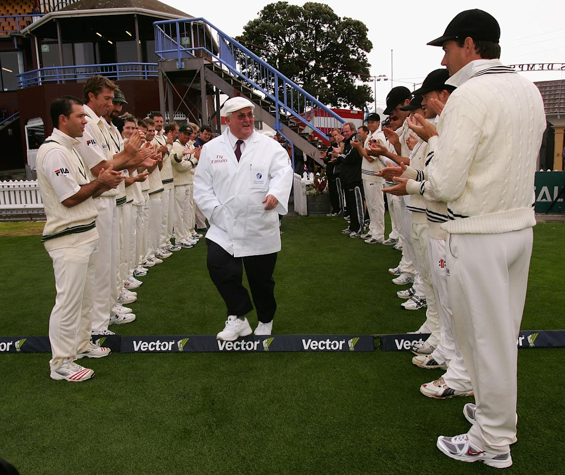 WELLINGTON, NEW ZEALAND - MARCH 19:  Umpire David Shepherd who is officiating his last match between the two sides is welcomed on to the field with a guard of honour from both the Australian and New Zealand teams during day two of the 2nd Test between New Zealand and Australia played at the Basin Reserve on March 19, 2005 in Wellington, New Zealand.  (Photo by Hamish Blair/Getty Images)