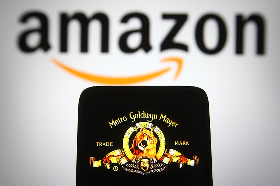 UKRAINE - 2021/05/18: In this photo illustration the Metro-Goldwyn-Mayer (MGM) logo of US media company is seen on a smartphone screen with an Amazon logo in the background. (Photo Illustration by Pavlo Gonchar/SOPA Images/LightRocket via Getty Images)