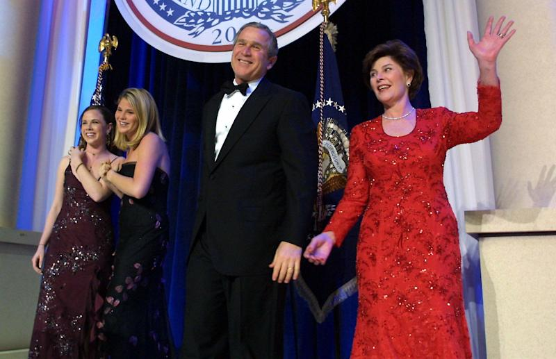 United States President George W. Bush (C), his wife Laura, and daughters Jenna and Barbara, attend the first inaugural ball in Washington, DC.