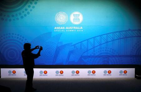 A cameraman takes a photograph using an iPhone of the stage for the Leaders Welcome and Family Photo during the one-off summit of 10-member Association of Southeast Asian Nations (ASEAN) in Sydney, Australia, March 17, 2018.     REUTERS/David Gray