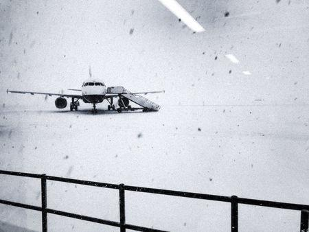 Heavy snow falls on the tarmac of the Glasgow Airport in Glasgow, Britain February 28, 2018 in this image taken from social media. Allan Barr Twitter @allanbarr/via REUTERS