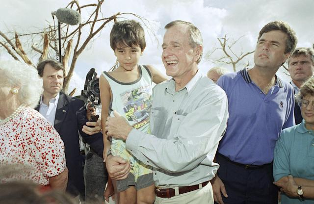 <p>President George H. W. Bush, First Lady Barbara Bush and son Jeb visit victims of Hurrcane Andrew in Florida on September 1, 1992. (AP) </p>