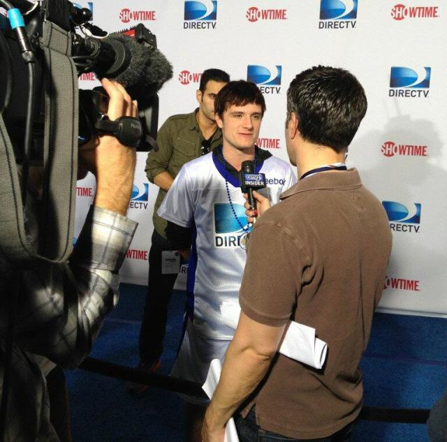 """The Hunger Games Josh Hutcherson getting ready for #BeachBowl "" Go Team Peeta!"