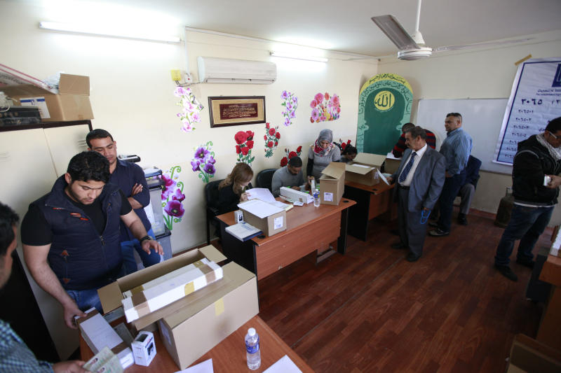 Election officials prepare to distribute voter ID cards to Iraqi citizens in Baghdad, Iraq, Saturday, Feb. 22, 2014. A spokesman for Iraq's election commission says authorities have begun to distribute voter ID cards in all but one of the country's 18 provinces, preparing for an April election that will be the first since the 2011 withdrawal of the U.S. forces. (AP Photo/Karim Kadim)